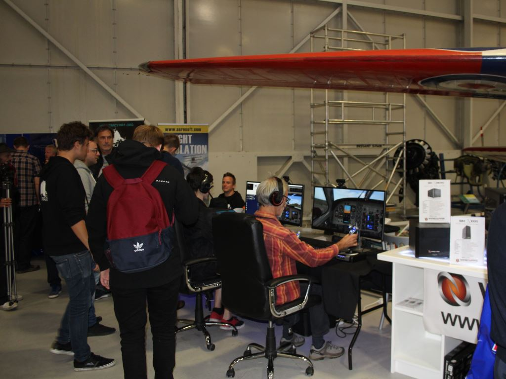 Visitors trying out flight sim on Wired2Fire PCs