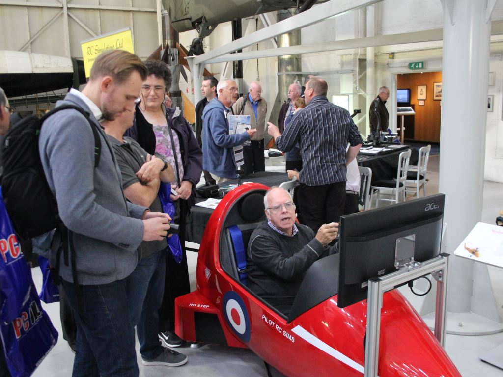 Visitors trying out a hawk cockpit simulator
