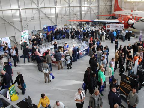 Looking down on the main exhibition area to see all stands busy with visitors