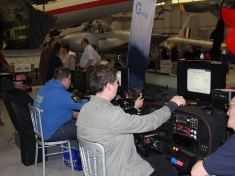 A group of simmers trying out various setups, including a realistic cockpit control setup