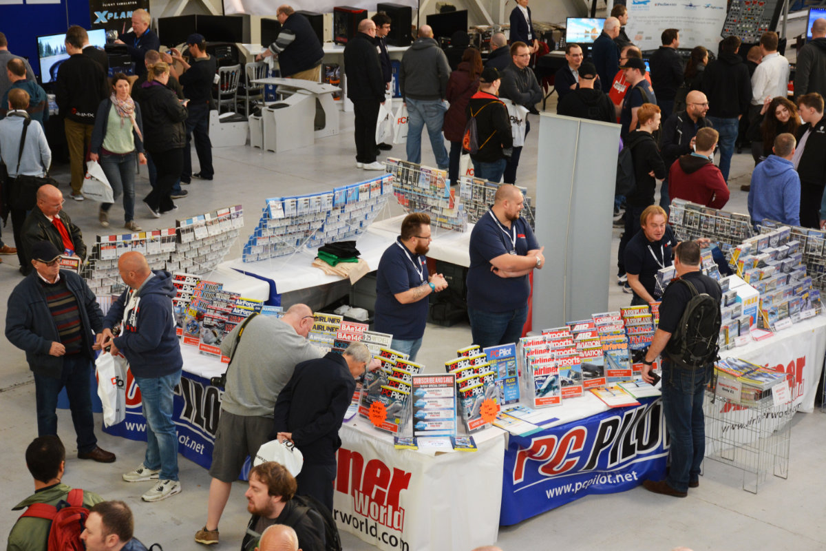 Zoomed in shot of the PC Pilot stand and visitors in the main exhibition area