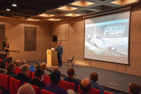 Dovetail presenting an update of their Flight Sim World simulator in the auditorium