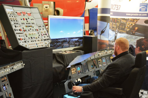 A visitor tries out some serious Flight Sim hardware from SKALARKI electronics