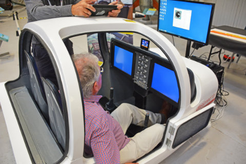 A visitor tries the dual-seat fibreglass cockpit from RC Simulations
