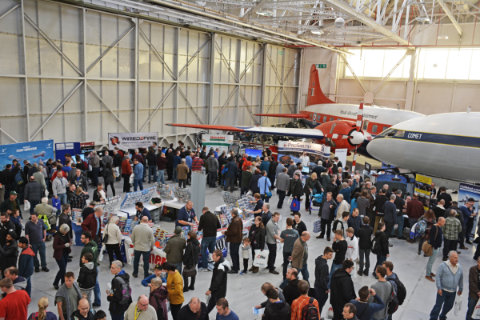 Looking down at the crowd of visitors in the hangar