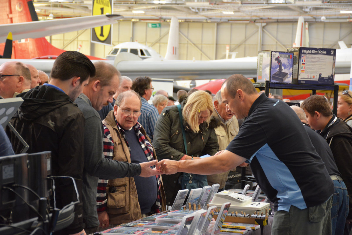 Visitors buying products at the Just Flight stand