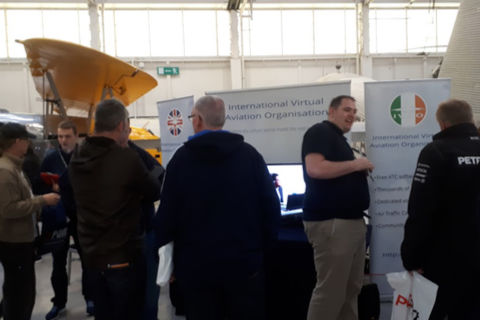 Visitors in discussion at the IVAO stand