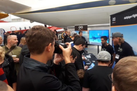 Visitors seeing a different type of sim at the Infinite Flight stand