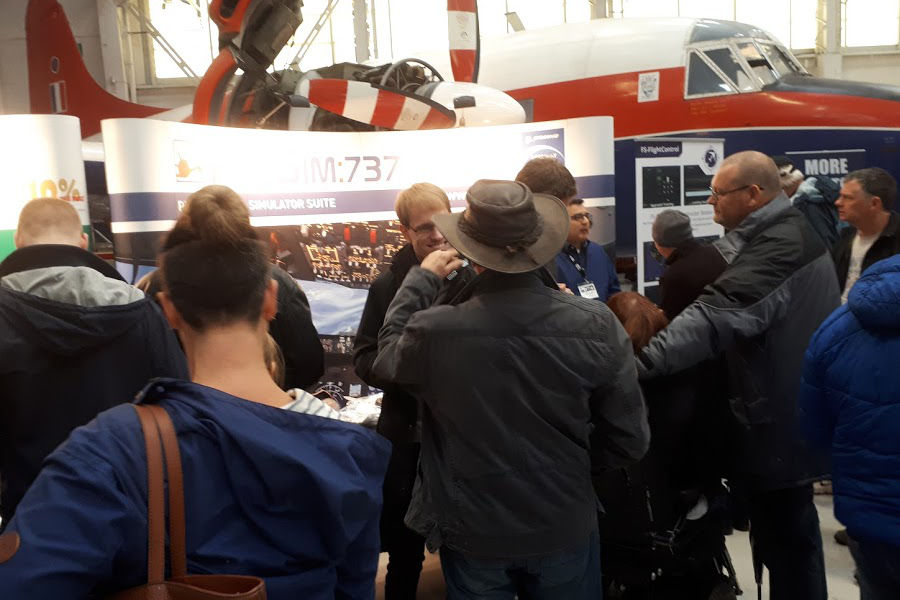 Visitors in discussion at the ProSim stand
