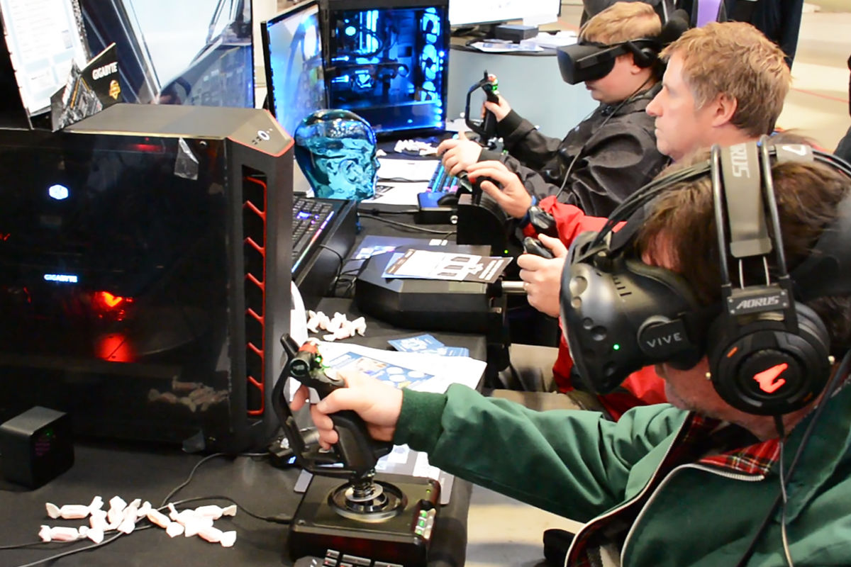 Visitors trying out flight sim in VR