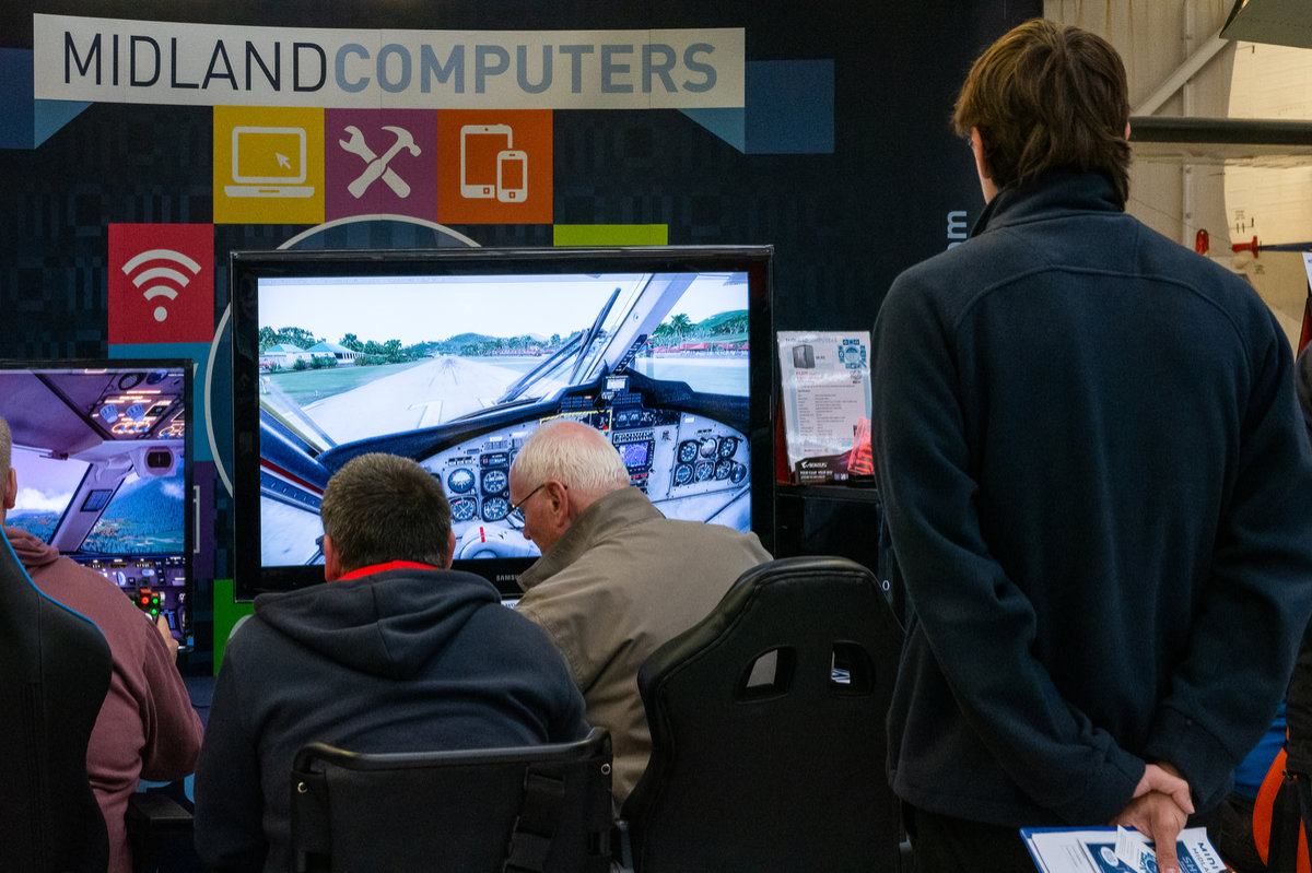 Visitors try out PC systems from Midland Computers
