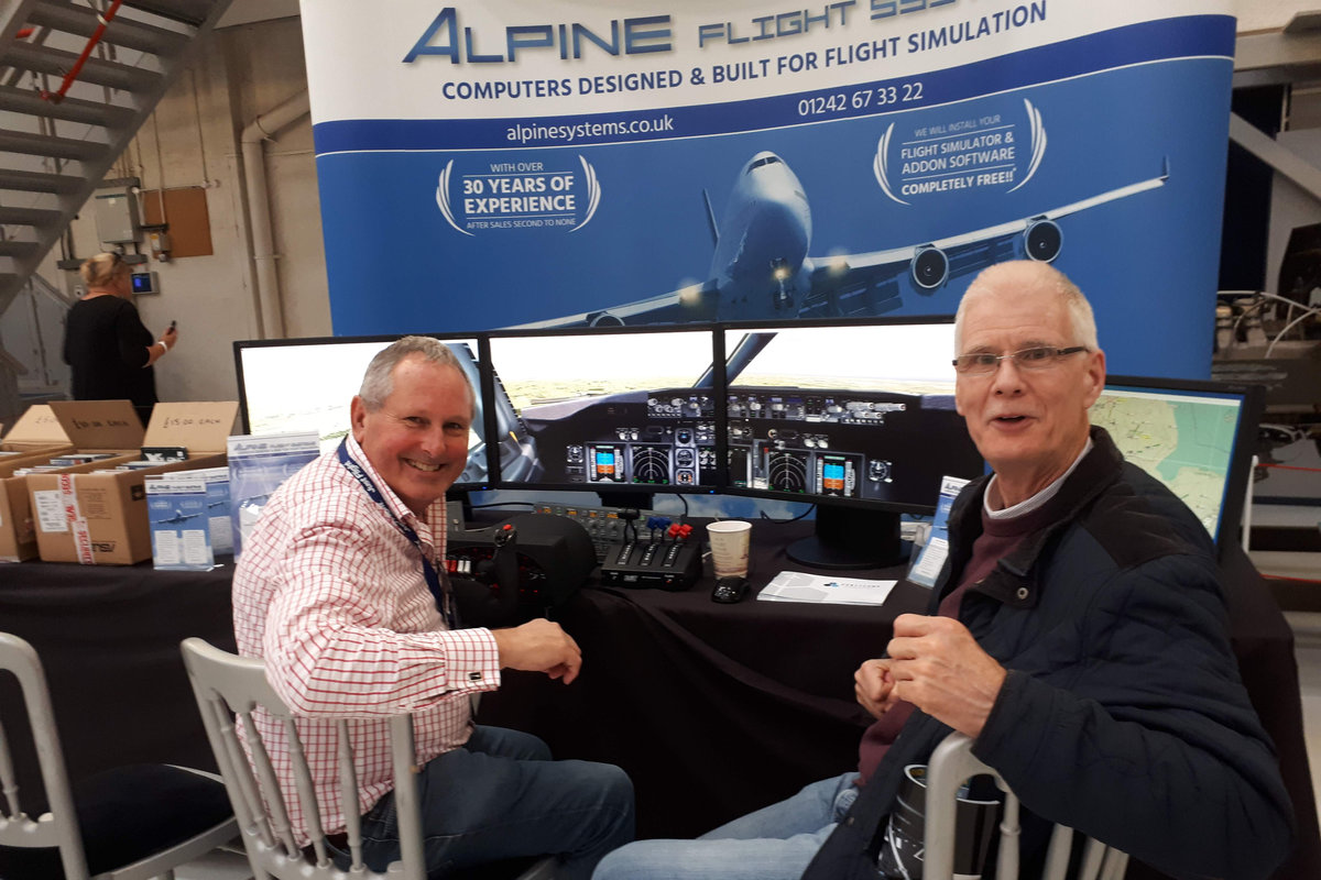 Visitors enjoying the display at the Alpine stand