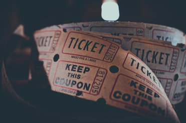 A reel of old-fashioned cinema tickets